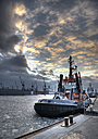 Germany, Hamburg, View of tugs at harbour in winter - WBF000451