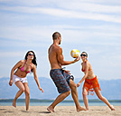 Croatia, Zadar, Friends playing volley ball at beach - HSIF000047