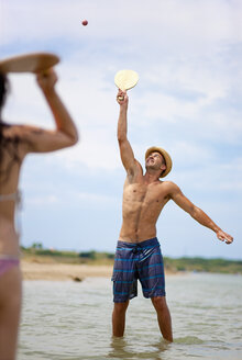 Croatia, Zadar, Couple playing at beach - HSIF000051