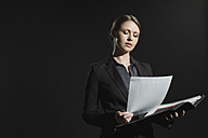 Young woman holding documents - WESTF015782
