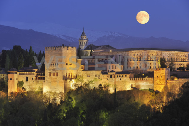 Spain, Andalusia, Granada Province, View of Alhambra Palace illuminated at night - RUEF000617