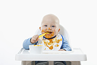 Baby boy (6- 11 Months) eating baby food with baby spoon - RBF000432