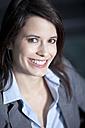 Germany, Bavaria, Business woman smiling, portrait - MAEF002698