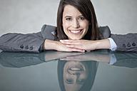 Germany, Bavaria, Business woman smiling, portrait - MAEF002754