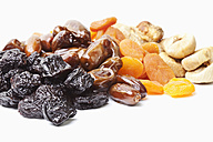 Variety of dried fruits on white background - MAEF002830