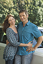 Germany, Bavaria, Mature couple with car, smiling, portrait - CRF002009