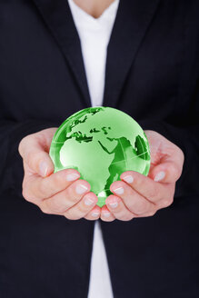 Woman holding green globe - TSF000130