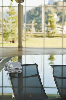 Italy, South Tyrol, Swimming pool  and sun lounger in hotel urthaler - WESTF015890