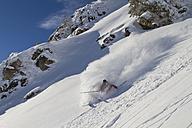 Austria, Tyrol, Kitzbuehel, Mature man skiing - FFF001141