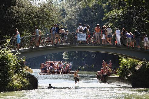 Germany, Bavaria, Upper Bavaria, Munich, Thalkirchen, Tourist on raft at Isar Flosskanal canal - SIE000231