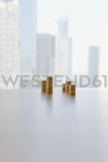 Germany, Frankfurt, Stack of coins in office - SKF000420