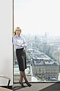 Germany, Frankfurt, Business woman with arms crossed, portrait - SKF000441
