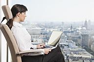 Germany, Frankfurt, Business woman using laptop - SKF000459