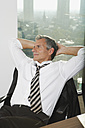 Germany, Frankfurt, Businessman resting in office - SKF000495