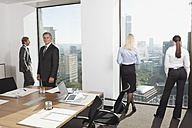 Germany, Frankfurt, Business people in conference room - SKF000543