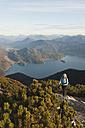 Germany, Bavaria, Senior woman at heimgarten and herzogstand mountain ranges - MIRF000081