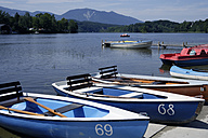Europe, Germany, Bavaria, Upper Bavaria, Boat moored in lake with mountain in background - TCF001383