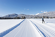 Germany, Bavaria, Isar Valley, Senior woman doing cross country skiing - MIRF000089