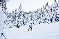 Germany, Bavaria, Isar Valley, Senior woman doing cross country skiing - MIRF000095
