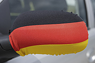 Germany, German flag on wing mirror of car - TCF001406