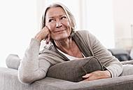 Germany, Wakendorf, Senior woman looking away, smiling - WESTF016194