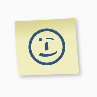 Smiley face sign on adhesive note, close-up - TSF000172