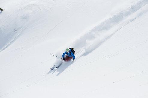 Austria, Kleinwalsertal, Woman skiing - MRF001245
