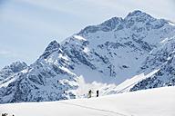 Austria, Kleinwalsertal,  Couple skiing - MRF001254