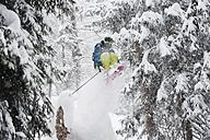 Austria, Kleinwalsertal, Male skier jumping mid-air - MRF001275