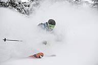 Austria, Kleinwalsertal,  Man skiing, low angle view - MRF001278