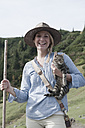 Austria, Salzburg Country, Filzmoos, Young woman with cat, smiling, portrait - HHF003460
