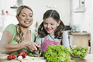 Germany, Cologne, Mother and daughter preparing salad - WESTF016296