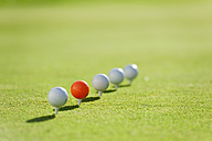 Italy, Kastelruth, Golf balls on golf course - WESTF016390