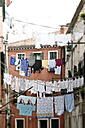 Italy, Venice, Laundry hanging on clothesline - MBEF000075