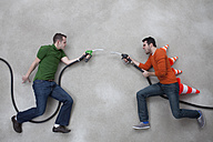 Young men fighting with fuel taps - BAEF000188