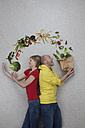 Man and woman balancing vegetables - BAEF000245