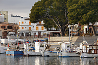 Spain, Balearic Islands, Majorca, Cala Ratjada, View of moored boat with buildings in background - SIEF000804