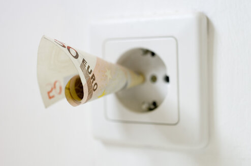 50 euro note kept into electrical socket, close up - MUF001024