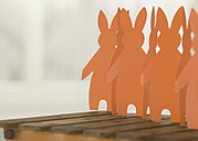 Paper garland of rabbit figurines, close-up - WBF000859