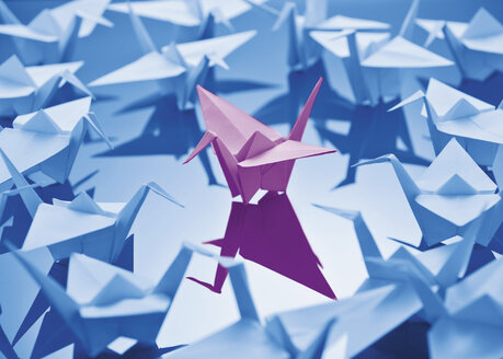 Paper crane on blue background - WBF000874