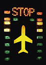 Germany, Lights with aircraft and stop sign on tower in airport - WBF000911