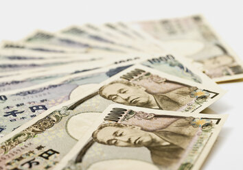 Japanese yen notes fanned out against white background - WBF001021