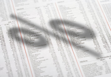 Percentage sign on newspaper with share prices - WBF001033