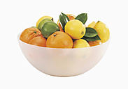 Bowl with fresh oranges and lemons against white background - WBF001054