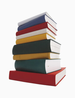 Stack of books against white background - WBF001093