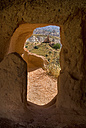 Turkey, Cappadocia, Goreme, View of red valley through window - PSF000539