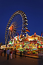 Germany, Bavaria, Munich, People celebrating oktoberfest at night - SIE000991