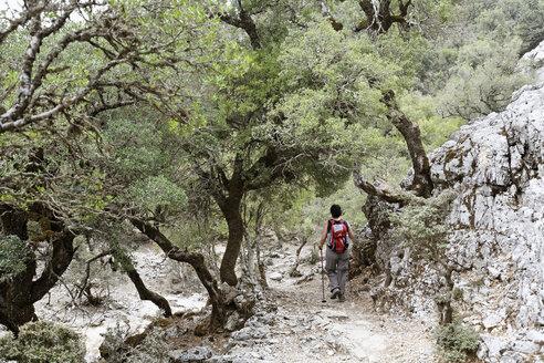 Greece, Crete, Mount Ida, Zaros, Rouvas Gorge, Mature woman hiking near gorge - SIEF001196