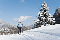 Germany, Bavaria, Aschermoos, Senior woman doing cross-country skiing - MIRF000101