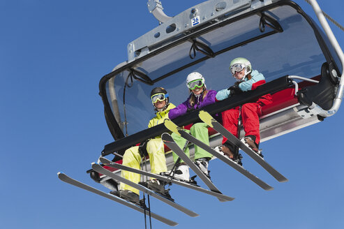 Italy, Trentino-Alto Adige, Alto Adige, Bolzano, Seiser Alm, Group of skiers using ski lift - MIRF000128